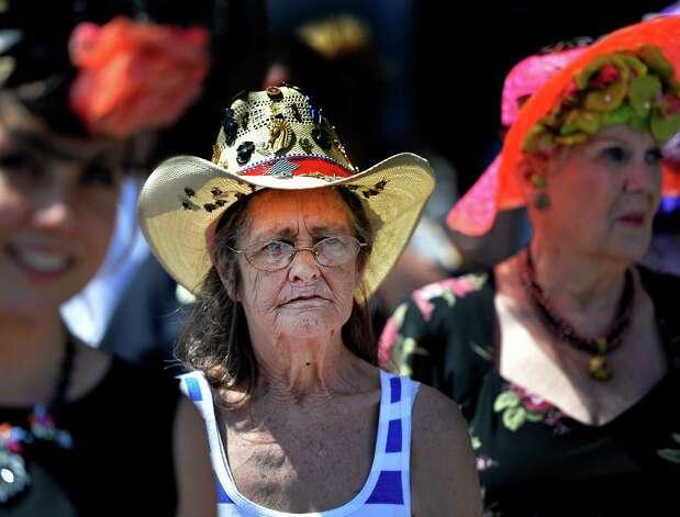 Joanne Dymond of Saratoga Springs waits her turn for judging with other entrants during the annual hat contest Sunday afternoon July 20, 2014 at the Saratoga Race Course in Saratoga Springs, N.Y.       (Skip Dickstein / Times Union) Photo: SKIP DICKSTEIN