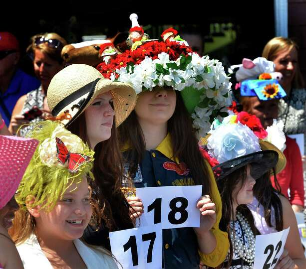 Entrants for the annual hat contest line up for judging Sunday afternoon July 20, 2014 at the Sar
