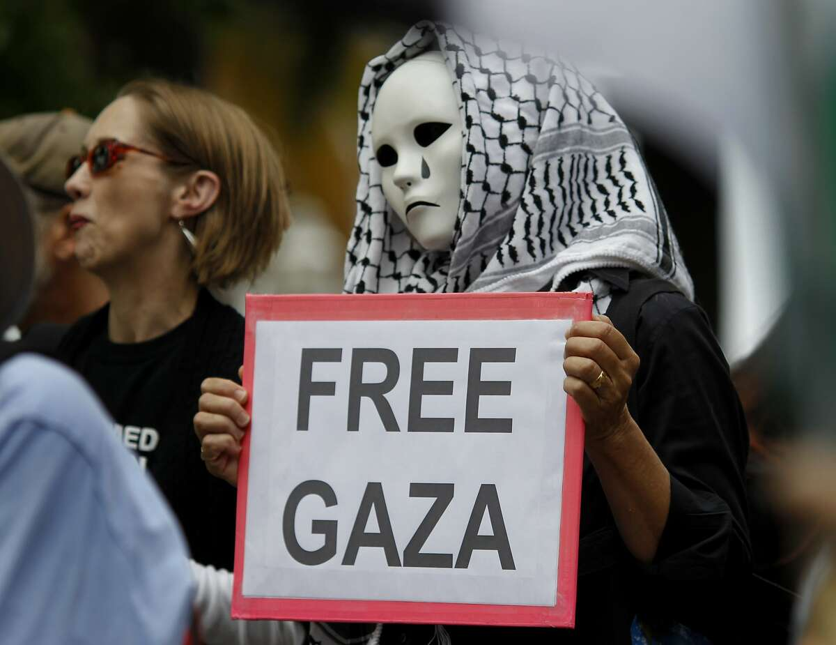 A protester put her feelings on a sign Sunday July 20, 2014. Hundreds of people marched in San Francisco, Calif. protesting the military actions by Israel in Gaza in recent days.