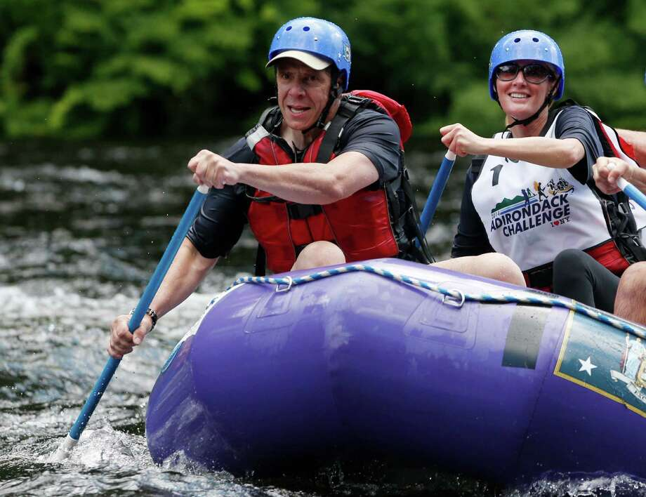 New York Gov. Andrew Cuomo, left, and his girlfriend Sandra Lee paddle with teammates during a rafting competition during the Adirondack Challenge on the Indian River on Sunday, July 20, 2014, in Indian Lake, N.Y. Cuomo and Vermont Gov. Peter Shumlin are squaring off in the rafting race meant to highlight the Adirondacks' recreational opportunities. (AP Photo/Mike Groll) ORG XMIT: NYMG103 Photo: Mike Groll / AP