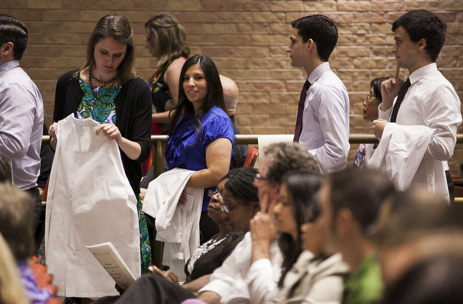Allie Cole (center), waiting during UTHSC's White Coat Ceremony, said she's pursuing neonatology after her fifth son was born 24 weeks premature. Now 5, her son is thriving. Photo: Julysa Sosa / For The Express-News / Julysa Sosa For the San Antonio Express-News