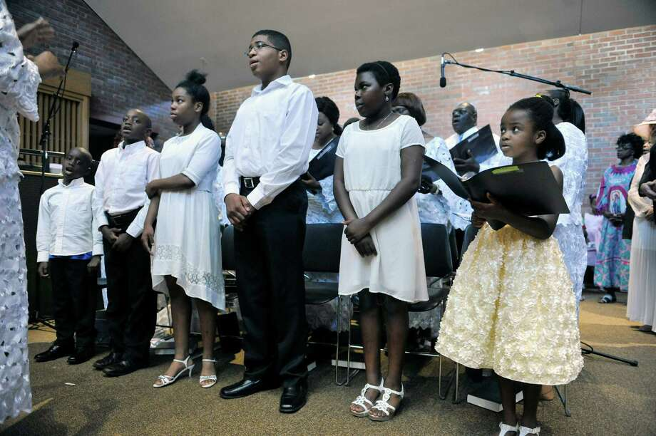 Members of the choir sing during a mass at the Saint Joan of Arc church on Sunday, July 20, 2014, in Menands, N.Y.    (Paul Buckowski / Times Union) Photo: Paul Buckowski / 00027840A