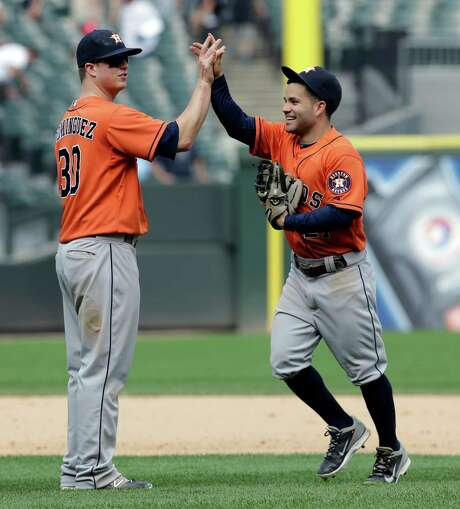 Two of the main contributors to the Astros' 17-hit attack - Matt Dominguez (three hits, four RBIs) and Jose Altuve (two hits, two RBIs) - enjoy the victory. Photo: Nam Y. Huh, STF / AP