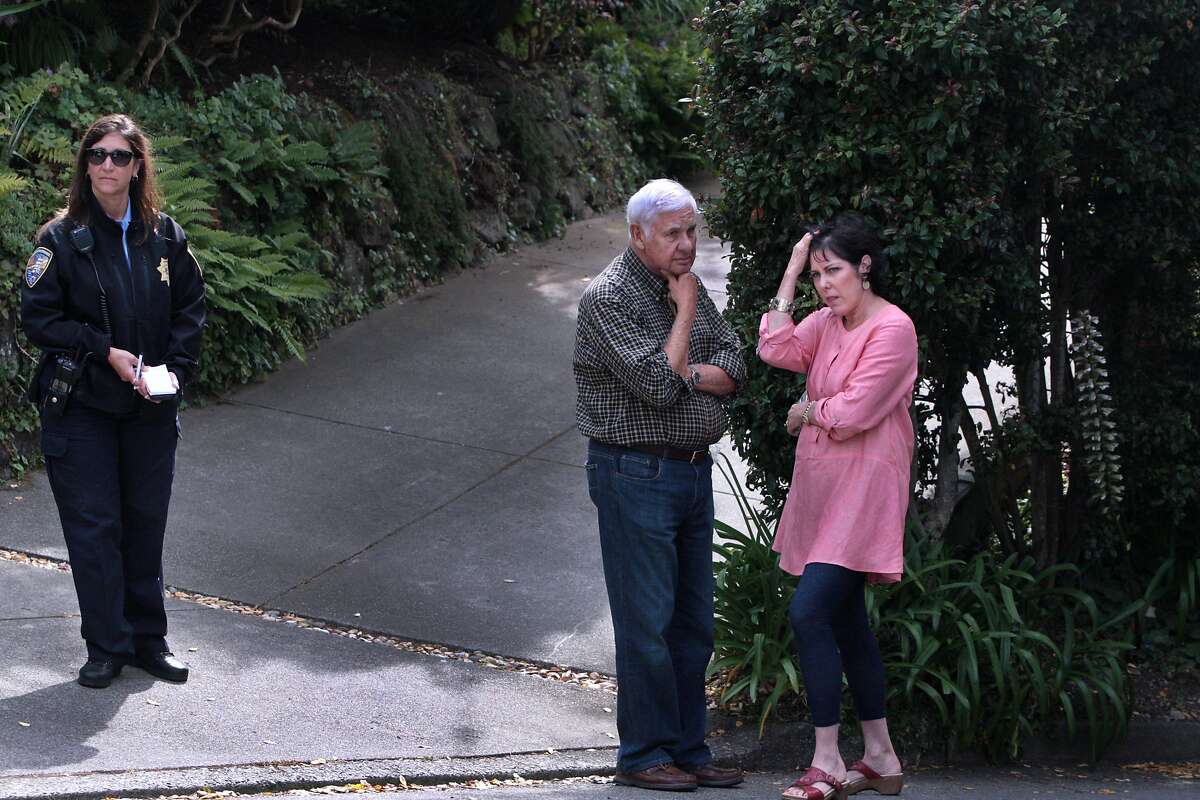 Sherrie Faber, right, speaks with a neighbor as members of the Sausalito Police Department, Marin County Sheriff's Office, Central Marin Police and Marin County Coroner's Office investigate two deaths inside a residence after a report of shots fired on Sunday, July 20, 2014 in the 100 block of San Carlos Avenue in Sausalito, Calif.