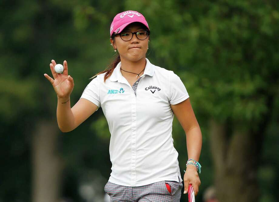 Lydia Ko closes in on her second LPGA victory Sunday, an achievement that makes the 17-year-old the youngest player to reach $1 million in career earnings. Photo: Gregory Shamus, Stringer / 2014 Getty Images