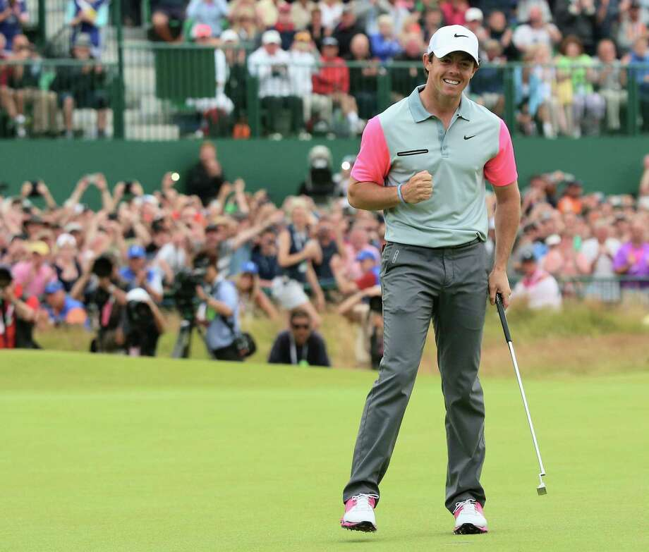 Rory McIlroy seals his wire-to-wire victory at Royal Liverpool, where he joined Jack Nicklaus (23) and Tiger Woods (24) as the only golfers to win three different majors by age 25. Photo: Andrew Redington / Getty Images / 2014 Getty Images