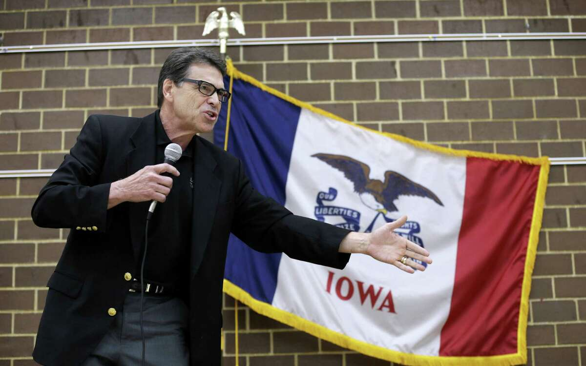 Gov. Rick Perry, shown over the weekend in Algona, Iowa, said Sunday that he would use his authority to send National Guard troops to the border if President Barack Obama won't.