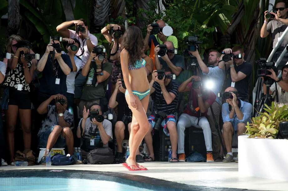 A model walks down the runway wearing swimwear from the Gottex collection during the Mercedes-Benz Fashion Week Swim show, Sunday, July 20, 2014, in Miami Beach, Fla. Photo: J Pat Carter, AP / AP