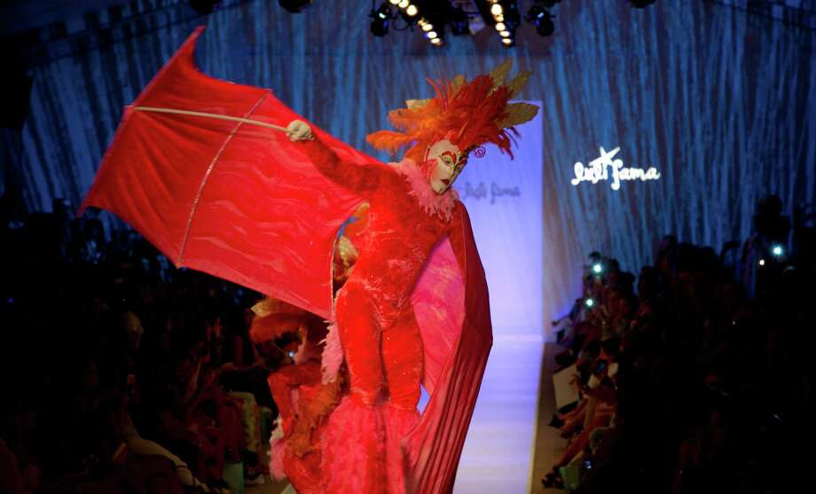 Stilt walkers and dancers open the Luli Fama collection show during the Mercedes-Benz Fashion Week Swim show, Sunday, July 20, 2014, in Miami Beach, Fla. Photo: J Pat Carter, AP / AP