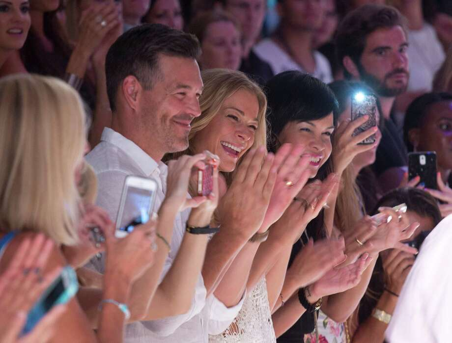 Country singer LeAnn Rimes, center, reacts after the Luli Fama collection during the Mercedes-Benz Fashion Week Swim show, Sunday, July 20, 2014, in Miami Beach, Fla. Photo: J Pat Carter, AP / AP2014
