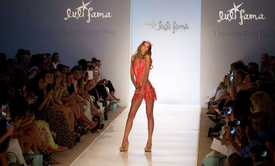 A model walks down the runway wearing swimwear from the Luli Fama collection during the Mercedes-Benz Fashion Week Swim show, Sunday, July 20, 2014, in Miami Beach, Fla. Photo: J Pat Carter, AP / AP