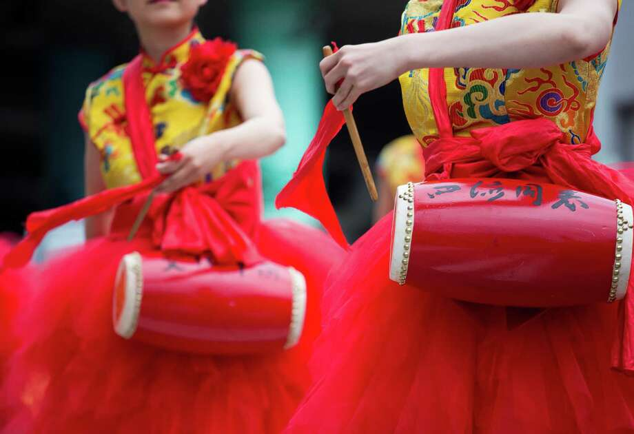 Thousands lined the streets of the International District to watch the Chinatown Seafair Parade on July 20, 2014. The parade featured lion and dragon dancing, various floats, and performances from several seattle-based drill teams. Photo: JOSHUA BESSEX, SEATTLEPI.COM / SEATTLEPI.COM