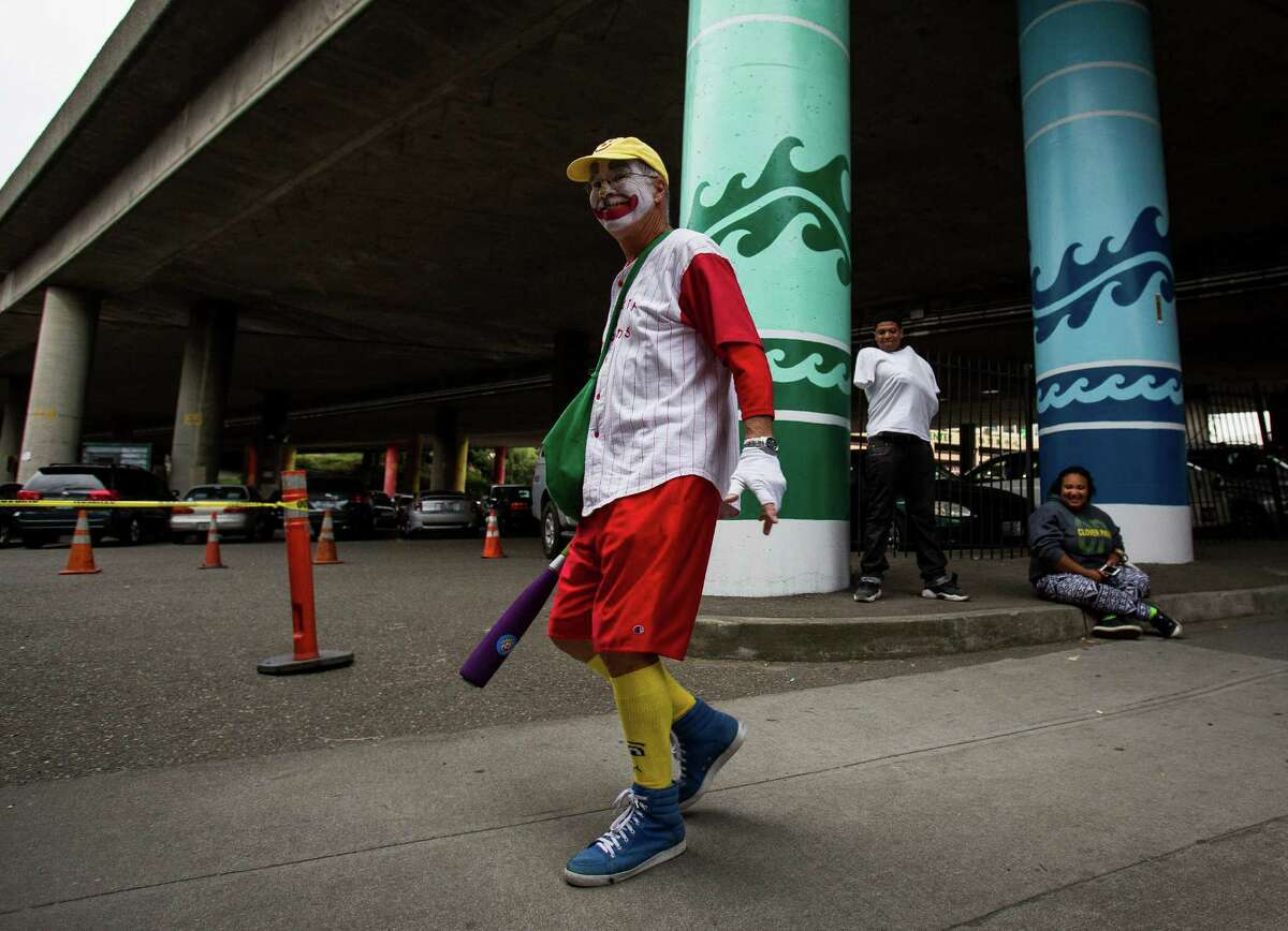 A clown walks down to his position prior to the parade. Thousands lined the streets of the International District to watch the Chinatown Seafair Parade on July 20, 2014. The parade featured lion and dragon dancing, various floats, and performances from several seattle-based drill teams.