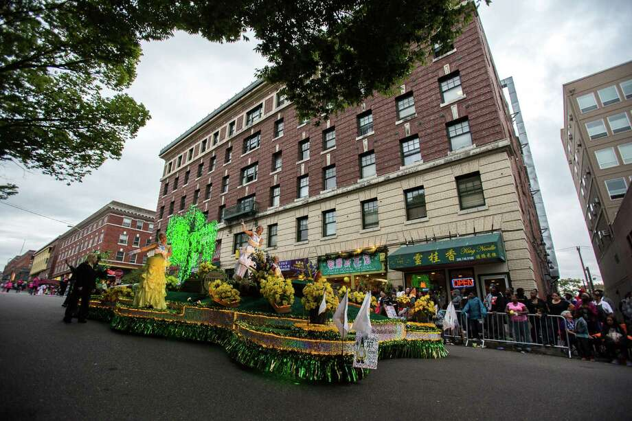 A Washington State Fairs float makes its way down the street. Thousands lined the streets of the International District to watch the Chinatown Seafair Parade on July 20, 2014. The parade featured lion and dragon dancing, various floats, and performances from several seattle-based drill teams. Photo: JOSHUA BESSEX, SEATTLEPI.COM / SEATTLEPI.COM