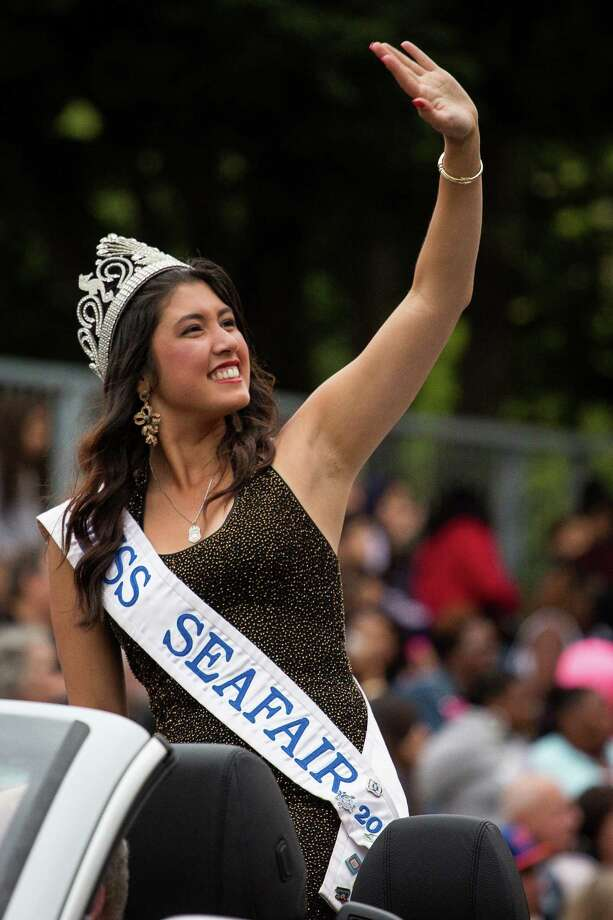 Miss Seafair Emily Rio Barber waves to the crowd during the parade. Thousands lined the streets of the International District to watch the Chinatown Seafair Parade on July 20, 2014. The parade featured lion and dragon dancing, various floats, and performances from several seattle-based drill teams. Photo: JOSHUA BESSEX, SEATTLEPI.COM / SEATTLEPI.COM