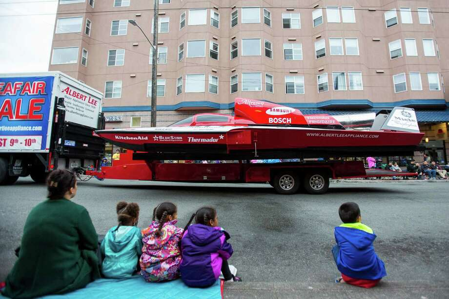 Children watch as a hydroplane is pulled through the parade. Thousands lined the streets of the International District to watch the Chinatown Seafair Parade on July 20, 2014. The parade featured lion and dragon dancing, various floats, and performances from several seattle-based drill teams. Photo: JOSHUA BESSEX, SEATTLEPI.COM / SEATTLEPI.COM