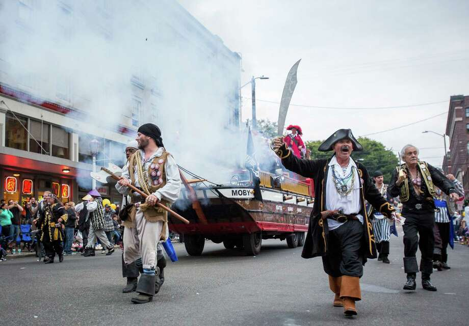 The Seafair pirates march during the parade. Thousands lined the streets of the International District to watch the Chinatown Seafair Parade on July 20, 2014. The parade featured lion and dragon dancing, various floats, and performances from several seattle-based drill teams. Photo: JOSHUA BESSEX, SEATTLEPI.COM / SEATTLEPI.COM