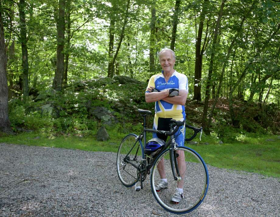 Standing in the yard of his Roxbury home, Peter Pappas, 76, displays the Cannondale bike he uses to ride 50 to 75 miles a week, either in New York's Central Park or on the roads around Roxbury Conn. Pappas is participating in the 10th annual Bike Ct Challenge Ride on July 26. Ct Challenge supports programs that empower cancer survivors to live healthier and longer lives. Sunday, July 20, 2014 Photo: H John Voorhees III / The News-Times Freelance