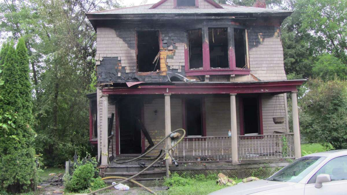 A vacant home at 705 Third Ave., Troy, appeared to be the most seriously damaged in a spree of fires that started in Lansingburgh about 3 a.m. and 6 a.m. Monday. (Bob Gardinier / Times Union)