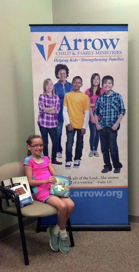 Madison Henson with her first donation of bibles courtesy photo
