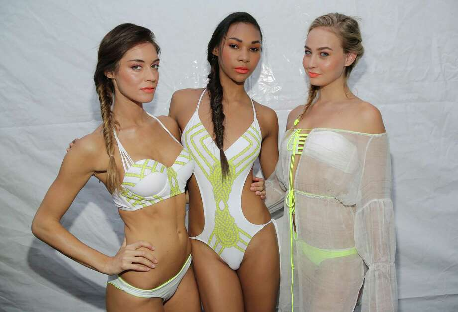 Models are seen backstage at Belusso fashion show during Mercedes-Benz Fashion Week Swim 2015 at Oasis at the Raleigh Hotel on July 20, 2014 in Miami, Florida. (Photo by Alexander Tamargo/Getty Images for Belusso) Photo: Alexander Tamargo, AP  / 2014 Getty Images