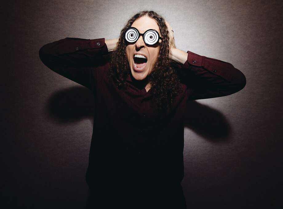 "In this July 17, 2014 photo, ""Weird Al"" Yankovic poses for a portrait in Los Angeles. Billboard reported that Yankovic's ""Mandatory Fun"" debuted at No. 1 this week with more than 80,000 units sold. That's almost double the amount his last album, ""Alpocalypse,"" sold in its debut week in 2011. (Photo by Casey Curry/Invision/AP) Photo: Casey Curry, Associated Press"