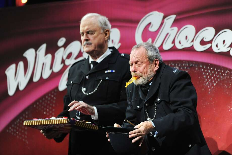 (L-R) John Cleese and Terry Gilliam perform on the closing night of 'Monty Python Live (Mostly)' at The O2 Arena on July 20, 2014 in London, England. Photo: Dave J Hogan, Getty Images