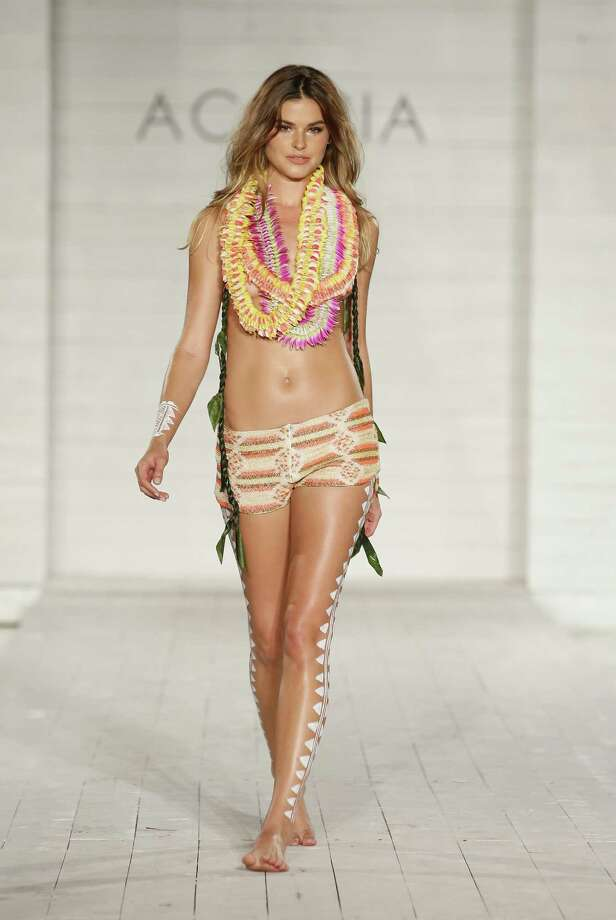 "The ""Just another beach day""Shorts, leis, weird leg art - good to go.   Photo: Neilson Barnard, Getty / 2014 Getty Images"