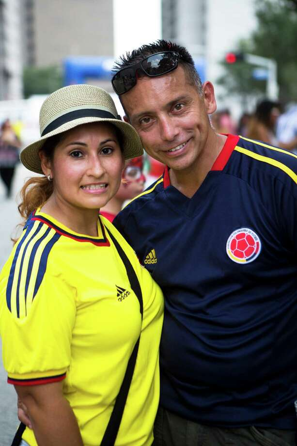 A couple arrives to the Colombian Fest 2014 to enjoy of the traditional food and music, Sunday, July 20, 2014, in Houston. Photo: Marie D. De Jesus, Houston Chronicle / © 2014 Houston Chronicle