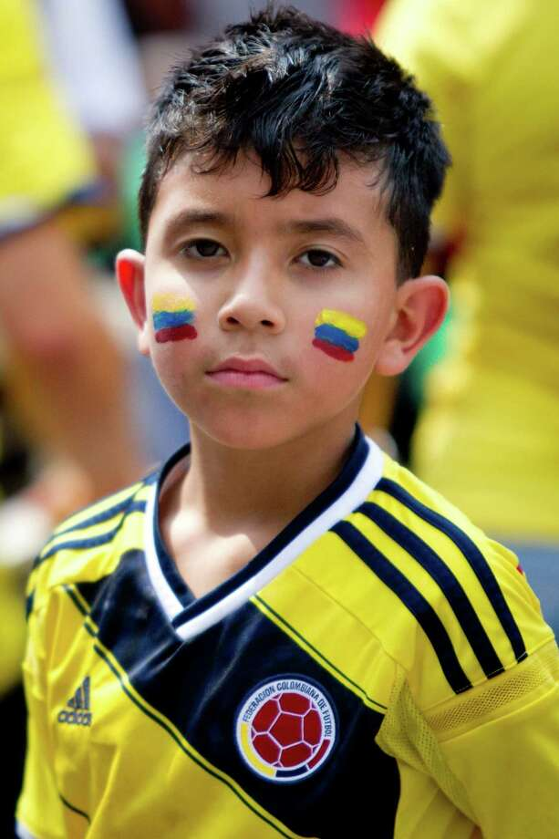 A boy wears the Colombian colors for Colombia independence day, Sunday, July 20, 2014, in Houston. Photo: Marie D. De Jesus, Houston Chronicle / © 2014 Houston Chronicle