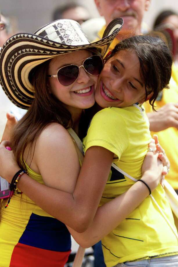 Friends greet each other early on the Colombian Fest 2014, Sunday, July 20, 2014, in Houston. Photo: Marie D. De Jesus, Houston Chronicle / © 2014 Houston Chronicle