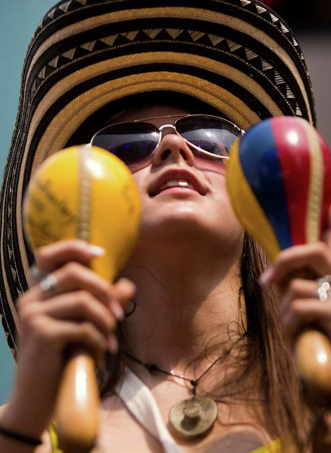 Natalia Giraldo, 18, arrived early to the Colombian Fest 2014 securing the front spots to enjoy the artists invited to perform at the festival during the Colombia Independence Day in Houston, Sunday, July 20, 2014. Photo: Marie D. De Jesus, Houston Chronicle / © 2014 Houston Chronicle