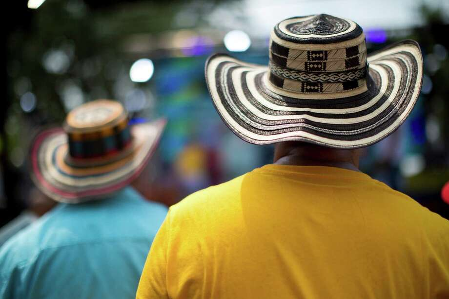 Sombrero vueltiados (Colombian Spanish for turned hats) are widely used during the Colombian Fest 2014 to battle the high temperatures and to identify themselves as Colobians. The hats are no longer just used as a traditional item for Colombian workers, but as a national symbol widely used by celebrities and patriotic artists. Sunday, July 20, 2014, in Houston. Photo: Marie D. De Jesus, Houston Chronicle / © 2014 Houston Chronicle