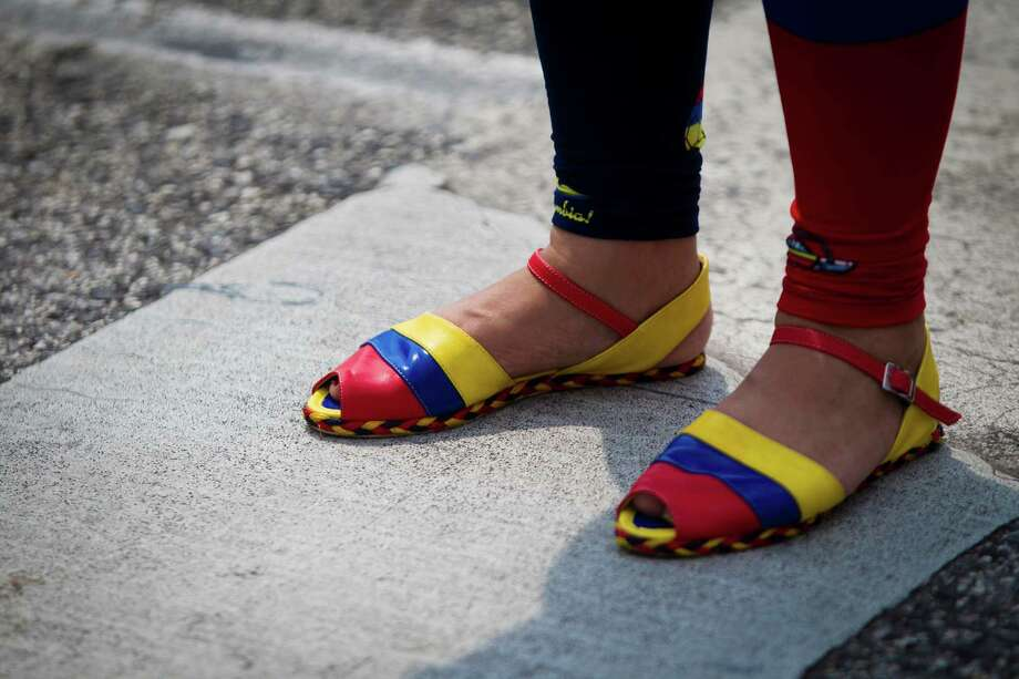 A woman wears sandals rocking the Colombian colors during the Colombian Fest  2014, Sunday, July 20, 2014, in Houston. Photo: Marie D. De Jesus, Houston Chronicle / © 2014 Houston Chronicle