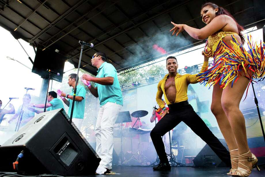 Professional dancers perform with the salsa group called Grupo Gale, of Medellin Colombian, during the Colombian Fest 2014, Sunday, July 20, 2014, in Houston. Photo: Marie D. De Jesus, Houston Chronicle / © 2014 Houston Chronicle
