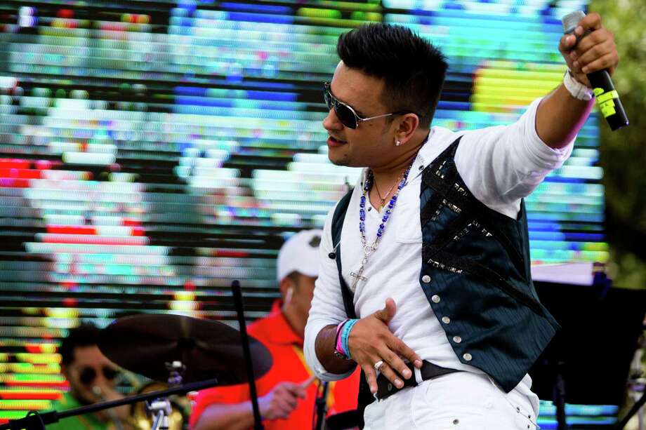 The Bolivian singer, Nacho Acero dances for the audience, which reacts with screens and applauds early in the Colombian Fest 2014, Sunday, July 20, 2014, in Houston. Photo: Marie D. De Jesus, Houston Chronicle / © 2014 Houston Chronicle