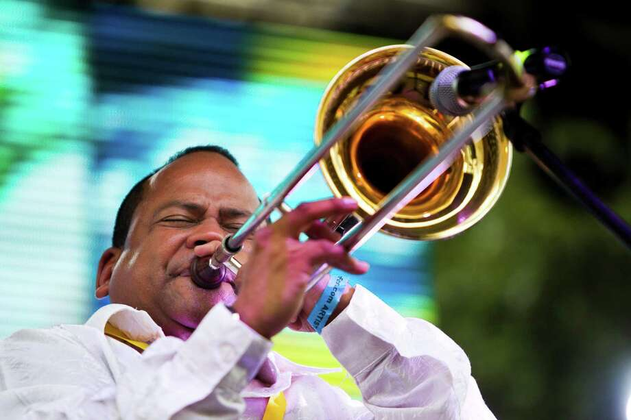 A member of the Raphy Leavitt Orquesta La Selecta from Puerto Rico, perforce a trombone solo at the Colombian Fest 2014, Sunday, July 20, 2014, in Houston. Photo: Marie D. De Jesus, Houston Chronicle / © 2014 Houston Chronicle