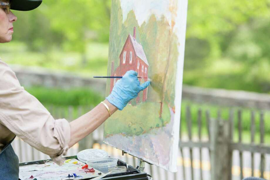 An artist paints at Weir Farm National Historic Site on the border of Ridgefield and Wilton. Photo: Contributed Photo / The News-Times Contributed