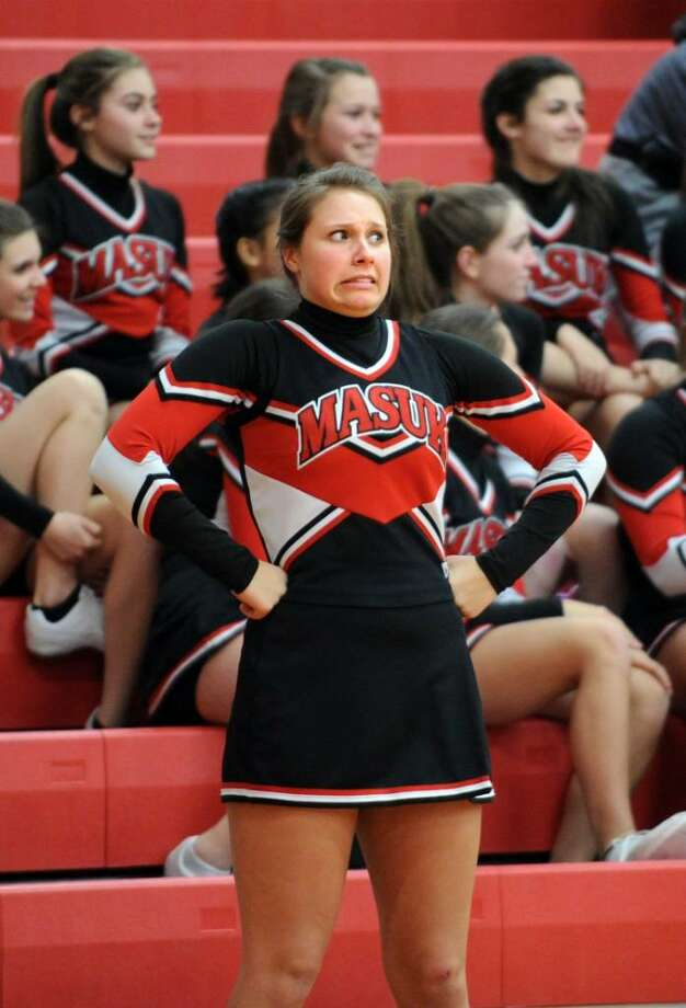 A Masuk cheerleader reacts during game action against Bunnell Wednesday Feb. 17, 2010 at Masuk. Photo: Autumn Driscoll / Connecticut Post