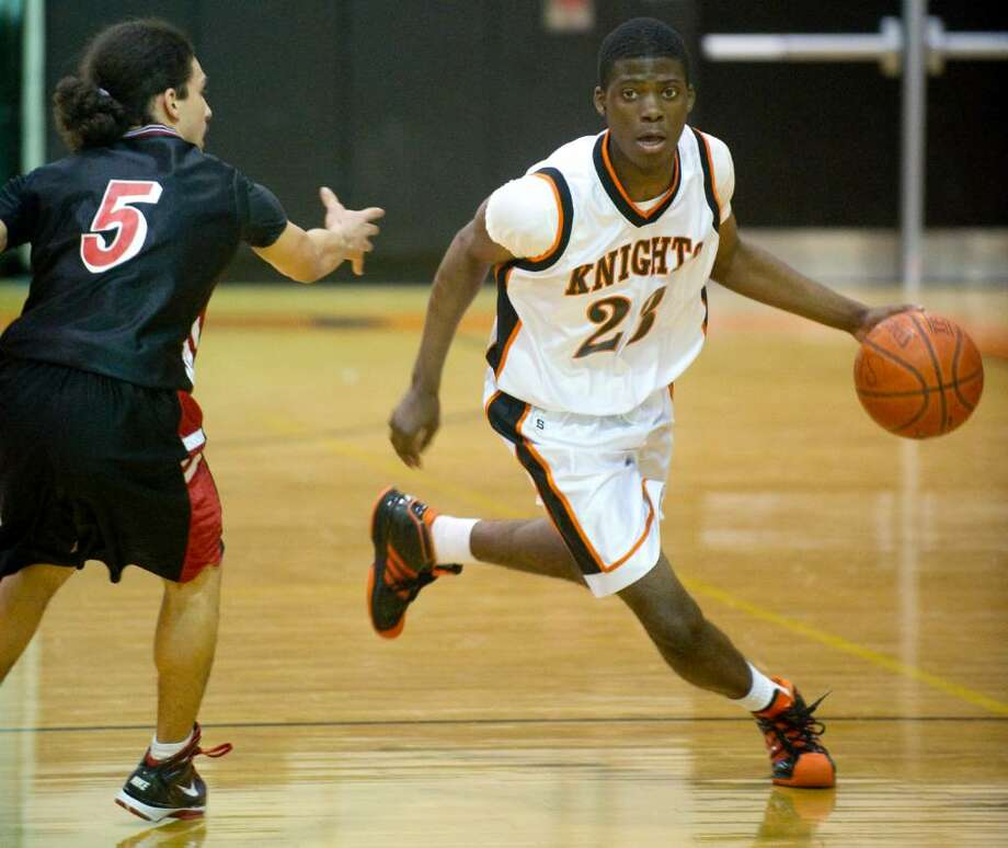 Stamford's Jethro Anilus, right, drives past Central's Chris Colon, left, during an FCIAC boys basketball game at Stamford High School in Stamford, Conn. on Wednesday, Feb. 17, 2010. Photo: Chris Preovolos / Stamford Advocate