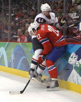 VANCOUVER, BC - FEBRUARY 18:  Brooks Orpik (#44) of the United States battles Martin Roymark of Norway during their ice hockey men's preliminary game between USA and Norway on day 7 of the 2010 Winter Olympics at Canada Hockey Place on February 18, 2010 in Vancouver, Canada.  (Photo by Bruce Bennett/Getty Images) *** Local Caption *** Brooks Orpik;Martin Roymark Photo: Bruce Bennett, Getty Images / 2010 Getty Images