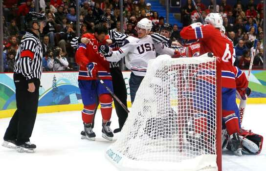 VANCOUVER, BC - FEBRUARY 18:  Officials break up a scuffle during the ice hockey men's preliminary game between USA and Norway on day 7 of the 2010 Winter Olympics at Canada Hockey Place on February 18, 2010 in Vancouver, Canada.  (Photo by Bruce Bennett/Getty Images) Photo: Bruce Bennett, Getty Images / 2010 Getty Images