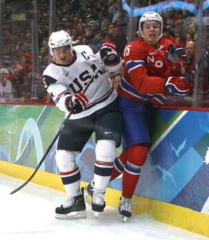 VANCOUVER, BC - FEBRUARY 18:  Jamie Langenbrunner of The United States and Martin Laumann Ylven of Norway collide on the boards during the ice hockey men's preliminary game between USA and Norway on day 7 of the 2010 Winter Olympics at Canada Hockey Place on February 18, 2010 in Vancouver, Canada.  (Photo by Bruce Bennett/Getty Images) *** Local Caption *** Jamie Langenbrunner;Martin Laumann Ylven Photo: Bruce Bennett, Getty Images / 2010 Getty Images