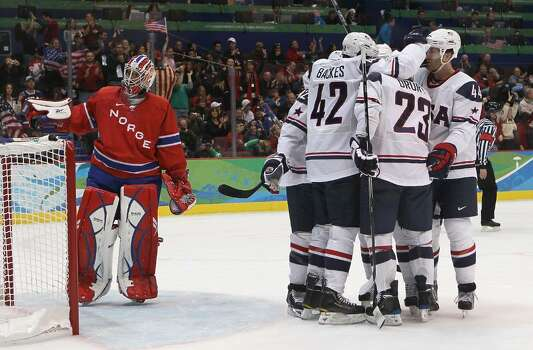 VANCOUVER, BC - FEBRUARY 18:  Chris Drury #23 of The United States celebrates with teammates after scoring his team's second goal during the ice hockey men's preliminary game between USA and Norway on day 7 of the 2010 Winter Olympics at Canada Hockey Place on February 18, 2010 in Vancouver, Canada.  (Photo by Bruce Bennett/Getty Images) *** Local Caption *** Chris Drury Photo: Bruce Bennett, Getty Images / 2010 Getty Images