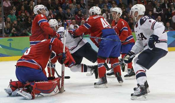 VANCOUVER, BC - FEBRUARY 18:  Paul Stastny of The United States is pushed off the puck by Mats Aasen Zuccarello of Norway during the ice hockey men's preliminary game between USA and Norway on day 7 of the 2010 Winter Olympics at Canada Hockey Place on February 18, 2010 in Vancouver, Canada.  (Photo by Bruce Bennett/Getty Images) *** Local Caption *** Paul Stastny;Mats Aasen Zuccarello Photo: Bruce Bennett, Getty Images / 2010 Getty Images