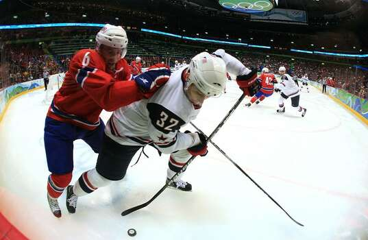 VANCOUVER, BC - FEBRUARY 18: Dustin Brown (#32) of the United States battles Jonas Holos of Norway during their ice hockey men's preliminary game between USA and Norway on day 7 of the 2010 Winter Olympics at Canada Hockey Place on February 18, 2010 in Vancouver, Canada.  (Photo by Bruce Bennett/Getty Images) *** Local Caption *** Dustin Brown;Jonas Holos Photo: Bruce Bennett, Getty Images / 2010 Getty Images