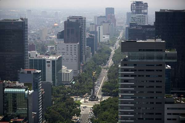 Traffic moves along Reforma Avenue, as seen from BBVA Bancomer's Mexico headquarters building under construction in Mexico City, Mexico, on Thursday, July 17, 2014. The 50 story office office tower will have approximately 78,600 square meters of office space and will accommodate about 4,500 employees when completed. Photographer: Susana Gonzalez/Bloomberg