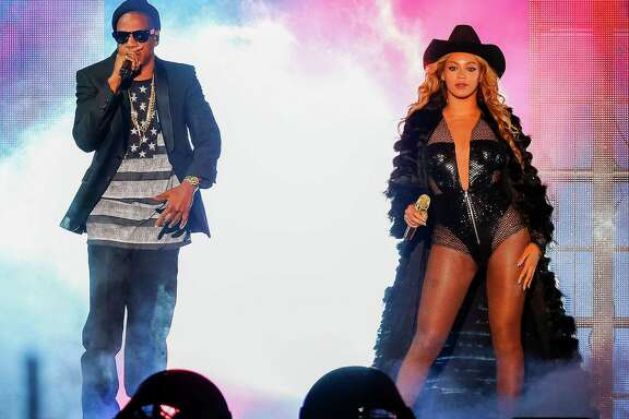 Beyonce and JAY Z perform on the On The Run Tour at the Minute Maid Park on Friday, July 18, 2014, in Houston, Texas.