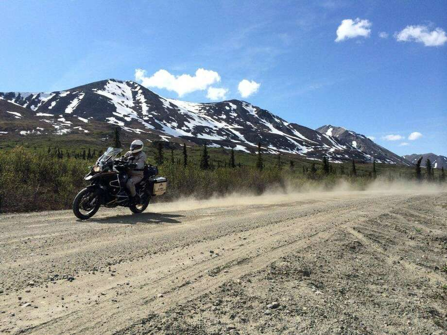 Riding along the Denali Highway of Alaska is all scenic vistas - sudden peaks appearing through the clouds, broad green valleys split by milky, glacial rivers - sort of a Yosemite on steriods. Photo: Charles Fleming, MBR / Los Angeles Times