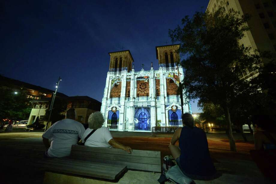 """People in Main Plaza watch """"San Antonio 